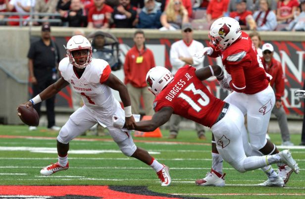 Houston Cougar QB, Greg Ward (left), Louisville Cardinal LB, James Burgess Jr. (right).