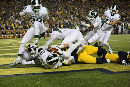 ANN ARBOR, MI - OCTOBER 17: The Michigan State Spartans celebrate in the endzone after defensive back Jalen Watts-Jackson #20 scored the game winning touchdown against the Michigan Wolverines during the final seconds of college football game at at Michigan Stadium on October 17, 2015 in East Lansing, Michigan. (Photo by Rey Del Rio/Getty Images)