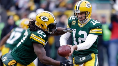 Packers' QB #12 Aaron Rodgers handing off to RB #27 Eddie Lacy