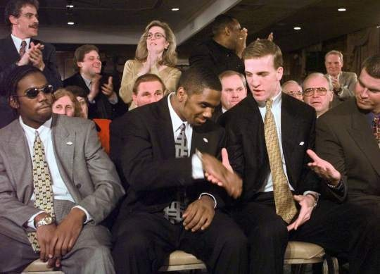 Charles Woodson, former defensive back for the University of Michigan, winning Heisman Trophy.