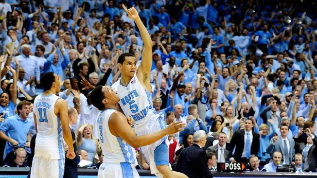 UNC guard Marcus Paige and forward Kennedy Meeks celebrating a win.