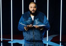 DJ Khaled holding the Air Jordan 16.